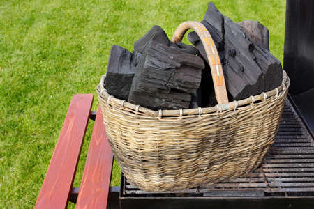kindling: Basket with charcoal on BBQ Grill