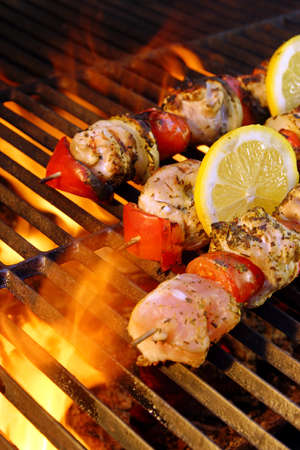 Flaming  BBQ grill and meat kabobs