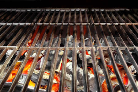 barbecue fire: Hot BBQ Grill and Glowing Coals  Background with space for text or image  Stock Photo