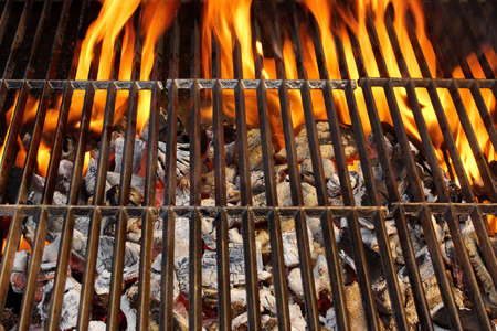 briquettes: Barbecue Grill and Burning Charcoal   Stock Photo
