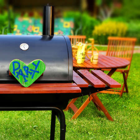 SummerParty Scene  BBQ Grill on the Lawn with sign  Party  on wooden heart  SummerParty Scene photo