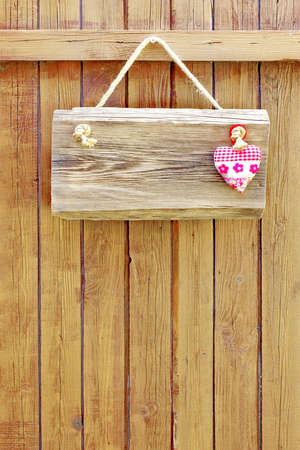 Hanging wood signboard with heart  Background with space for text or image photo