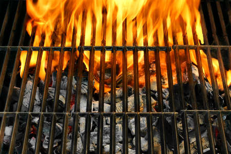 Flaming BBQ Grill close-up  Background  with space for text or image  photo