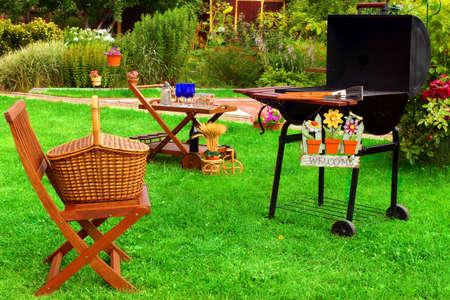 BBQ Grill, Picnic basket, garden furniture, signboard. Summer Party Scene. photo