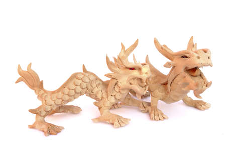 Wooden oriental dragon figurine Isolated on white photo