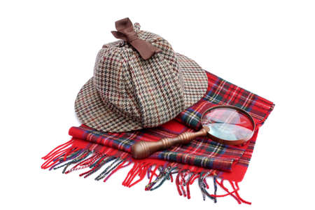 holmes: Deerhunter cap, magnifying glass, tartan scarves Isolated on white Stock Photo