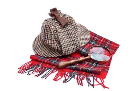 sherlock holmes: Deerhunter cap, magnifying glass, tartan scarves Isolated on white Stock Photo