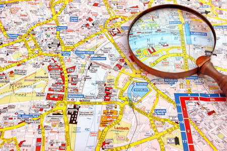 Map of London and magnifier glass. Themes river Close-up.
