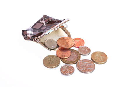 Purse and some english coins isolated on white background photo