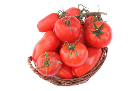 Different Ripe Tomatoes in wicker basket isolated on white background photo