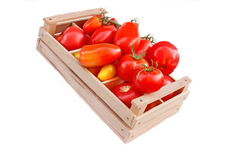 box size: Different colors and size Tomatoes in wooden box isolated on white background