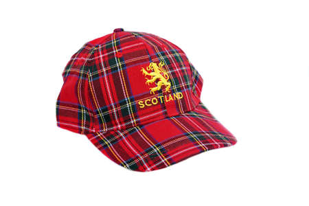 Red tartan cap with scottish arms  Isolated on White photo