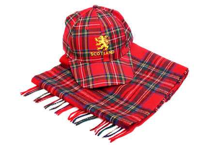 Red tartan cap with scottish arms and tartan scarves Isolated on White photo