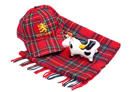 Scottish Red tartan cap, tartan scarves and highland cattle Isolated on White photo