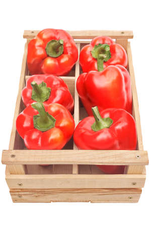 bell peppers: Bell Peppers in the wooden crate isolated on white background