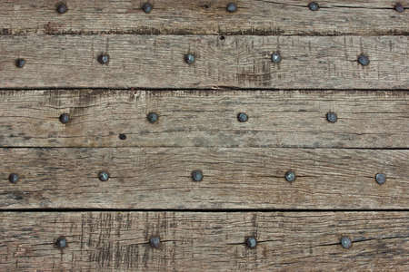 Old wooden planks with nails photo