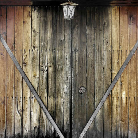 Old Wooden Gate with forging nails and handle. Background and Texture for text or image. photo