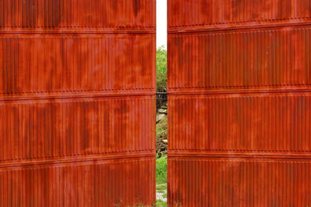 Rusty corrugated metal red wall and gate photo