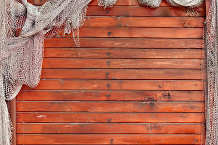 Hanging Fishnet on Wood Wall Background photo
