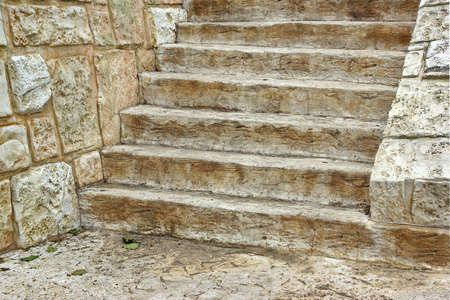 Old Wooden Staircase and stone wall Background photo
