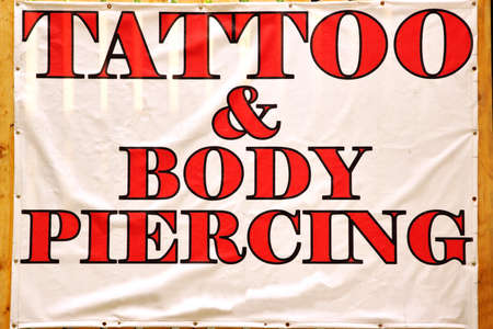 body piercing: Banner with text TATTOO & BODY PIERCING Background