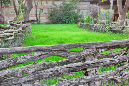Old Split Log Fence in a Decorative garden. Background for text or image photo