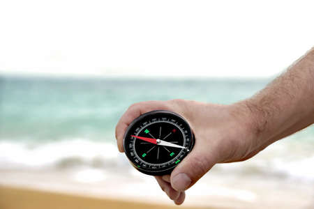 Male hand with Compass. Background with copy space photo