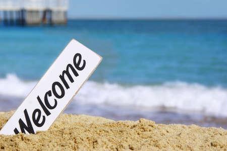 White Welcome Signboard on the Summer Sea Beach 版權商用圖片
