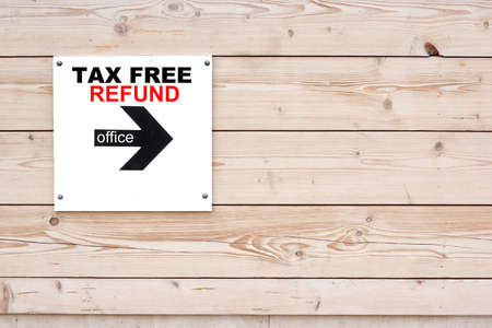 refund: TAX FREE REFUND OFFICE Black Sign on Whiteboard. Timber White Wall in Background