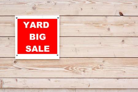 Yard Sale Sign on Natural Wood Wall photo