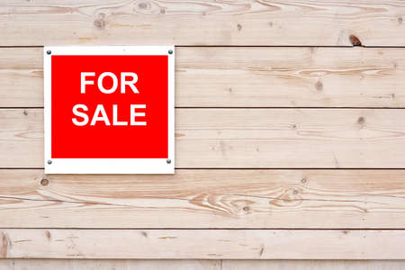 For Sale Red White Sign on Timber Wall photo