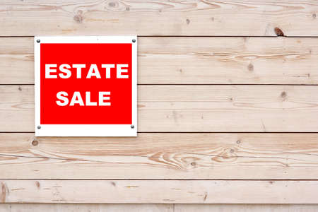 Estate Sale Red White Sign on Timber Wall photo