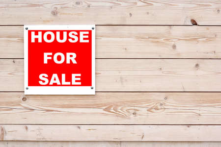 HOUSE FOR SALE Red White Sign on Timber Wall Background photo