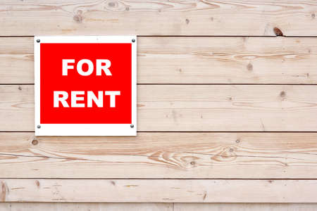 FOR RENT Red White Sign Red White Sign on Timber Wall Background photo