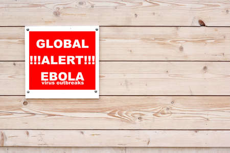outbreaks: GLOBAL ALERT EBOLA VIRUS OUTBREAKS Red White Sign on Timber Wall Background