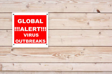 outbreaks: GLOBAL ALERT VIRUS OUTBREAKS Red White Sign on Timber Wall Background Stock Photo