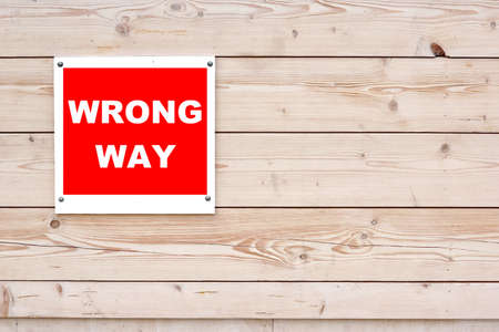 wrong way sign: WRONG WAY Sign Red White Sign on Timber Wall Background