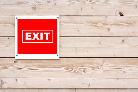 EXIT Red White Sign on Timber Wall Background photo