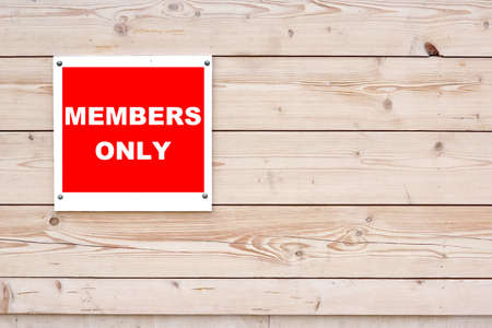 only members: MEMBERS ONLY Red White Sign on Timber Wall Background