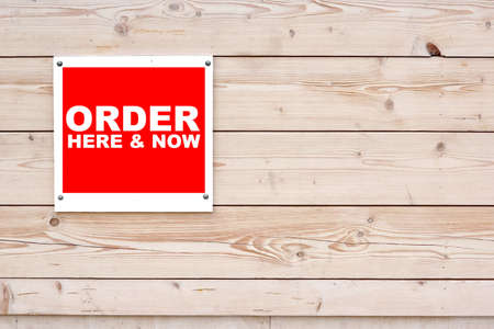 order here: ORDER HERE AND NOW Red White Sign on Timber Wall Background