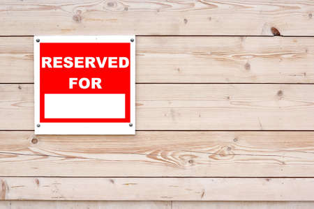RESERVED FOR Red White Sign on Timber Wall Background