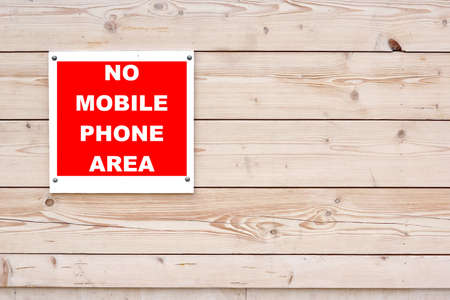 NO MOBILE PHONE AREA Red White Sign on Timber Wall Background Stock Photo - 33634317