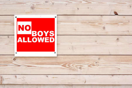 NO BOYS ALLOWED Red White Sign on Timber Wall Background
