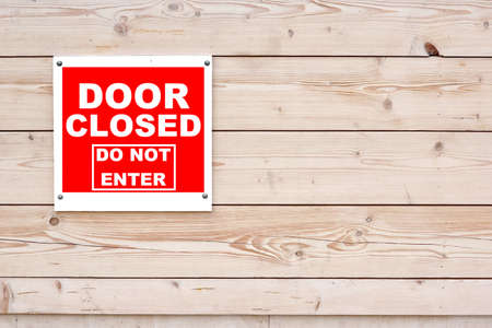 do not enter: DOOR CLOSED DO NOT ENTER Red White Sign Red White Sign on Timber Wall Background