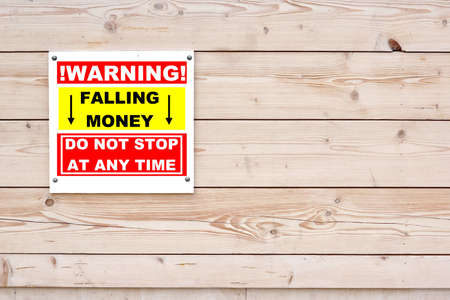 WARNING FALLING MONEY DO NOT STOP AT ANY TIME Sign Red White Sign on Timber Wall Background photo