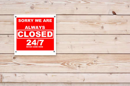 SORRY WE ARE ALWAYS CLOSED 247 NEVER COME HERE Red White Sign on Timber Wall Background photo