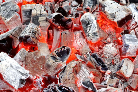 coals: Coals in Barbeque Pit. Background or Texture for text or image