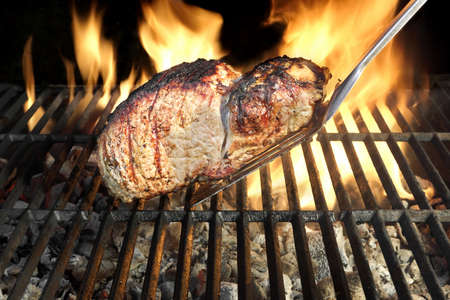 Grilled Pork Chop on the Hot BBQ Grill photo