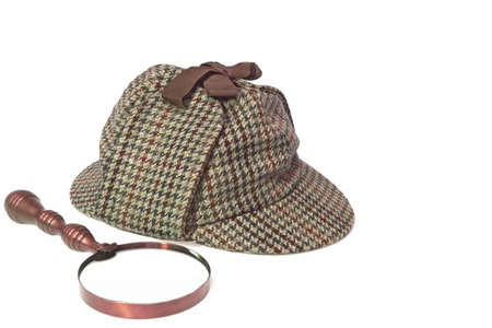 sleuth:  Hat or  Deerstalker Hat and Retro Magnifying Glass Isolated on White