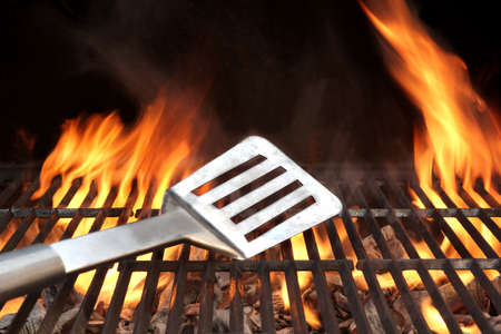 Spatula on the Barbecue Charcoal Fire Grill with Black Background